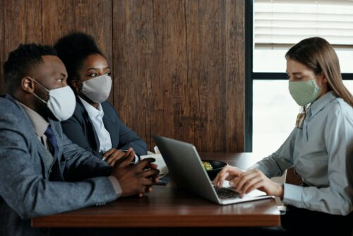 Interview at a desk with masks on